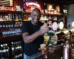 Having a crack at pouring a pint at Emersons in Dunedin yesterday is Shaun Wallace, of the...