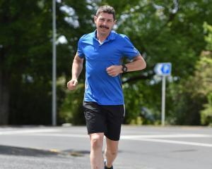 Chris Bisley goes for a jog in Dunedin after winning his fourth 100-mile race in the past year....