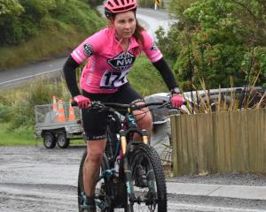 Claire Bell (Te Anau) rides on the 26km cycle stage of the Taieri Mouth Multisport Challenge...