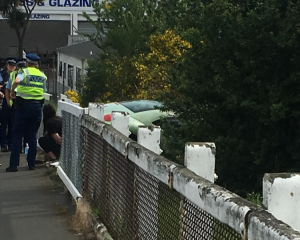 A car crashed through a fence on Anzac Ave this afternoon. Photo: Emma Perry