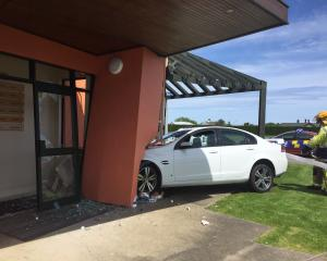 Two cars crashed and one ended up hitting the entrance of a medical practice in Invercargill...