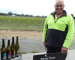 CharRees owner Charlie Hill with a selection of bottled wine made from grapes grown in Ashburton...
