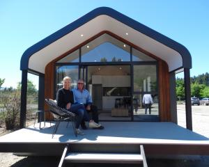 Claire and Peter Marshall on the deck of their Nautilus Modular house. Photo: Mark Price
