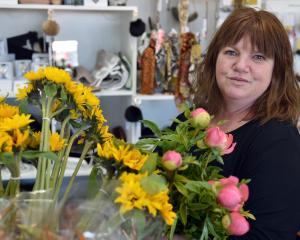 Linda McKenzie at work in her Mornington florist shop. PHOTO: GREGOR RICHARDSON