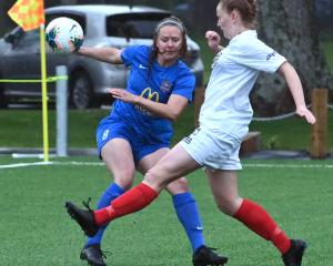 WaiBOP's Shannon Trebes (white) kicks the ball away from Southern's Renee Bacon yesterday during...