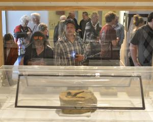 Viewing the moa feet on display at the Otago Museum are mother and son, Carolyn and Michael...