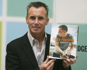British TV chef Gary Rhodes signs copies of his recipe book publication 'Keeping It Simple' in...