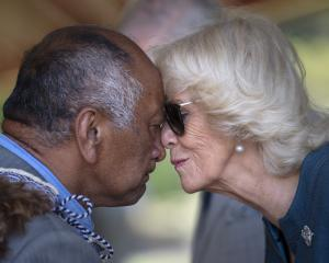Camilla, Duchess of Cornwall, receives the traditional hongi welcome from a man in Waitangi on...