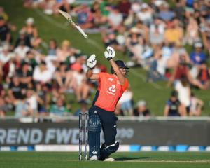 England's Dawid Malan lets go of his bat as he plays a shot against New Zealand at McLean Park in...
