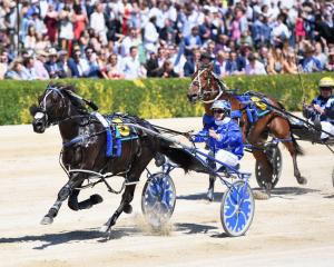 Natalie Rasmussen, driving Ultimate Sniper, wins ahead of David Butcher, driving Triple Eight, in...