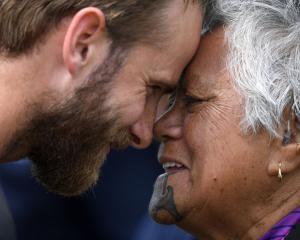 England captain Joe Root (left) and New Zealand captain Kane Williamson take part in a hongi...