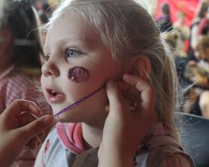 Opting for pinks and purples, Alexia Simpson (3) enjoyed having her face painted at the carnival...