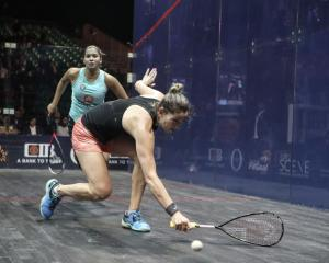 NZ squash player Joelle King (right) in action against Egypt's Zeina Mickawy during their women's...