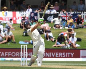 England's Jos Buttler hits a six. Photo: Reuters