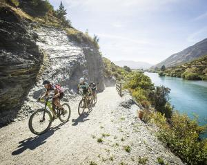 Riders negotiate the trail alongside the Kawarau River, heading to the finish last year. Photo:...