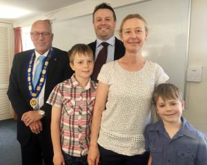 Queenstown Lakes Mayor Jim Boult (left) with newly sworn in councillor Glyn Lewers, his wife...