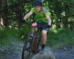Matthew Cowles (17) competes in the 15km MTB Experience race at the Coastal Classic at Taieri...