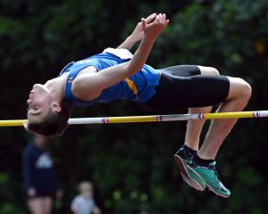 Tokomairiro High School pupil Millar McElrea competes in the high jump at the Caledonian Ground...