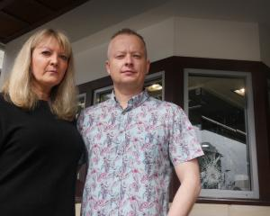 Jamies Jewellers owners Rachel and Clyde Vellacott assess the damage following an attempted...