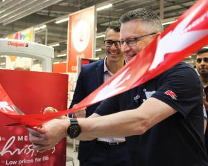 Invercargill Kmart store manager Forrest Worthen cuts the ribbon at the opening of the new store...