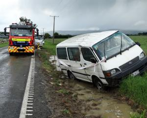 A van skidded into a ditch during a hailstorm.