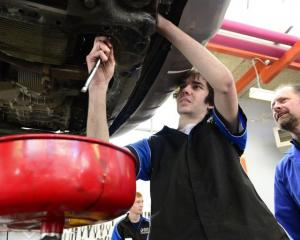 Otago Polytechnic automotive engineering student Issac Sonntag (18) works on an oil change, with...
