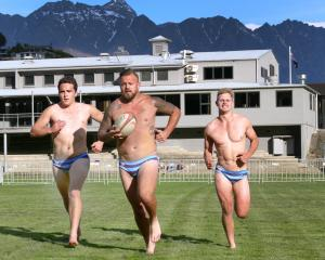 Wakatipu Rugby Club players (from left) Tom Ellis, Rhys Kearton and Logan Beggs stretch their...