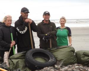 Kylie Coleman (left) and three of the other seven volunteers who worked together to pick up dead...