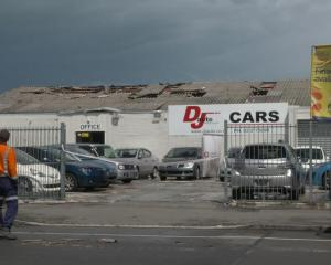 Asbestos removal workers were at DJ Auto in Sydenham on Tuesday morning. Photo: RNZ, Simon Rogers