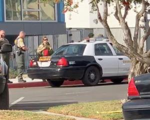 Sheriffs outside Saugus High School after a shooting in Santa Clarita, Californial Image: KHTS...