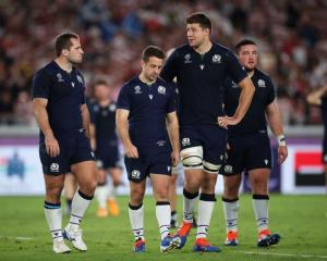 Scotland players Fraser Brown, Greig Laidlaw and Grant Gilchrist walk off the field after losing...