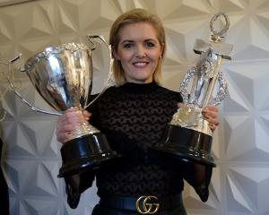 Moha Hairdressing co-owner Kylie Hayes displays two of the six trophies she won at The Industry...