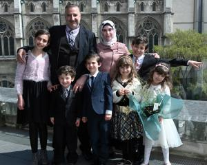 Mouhannad Taha and Lina Alhaj Shahin with their children (from left) Zenah (12), Ahmad (4), Faek ...