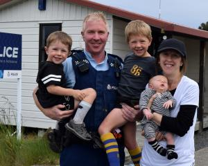Constable Allan Lynch, his wife Kirsty and sons (from left) Ollie, Richie and Fergus outside...