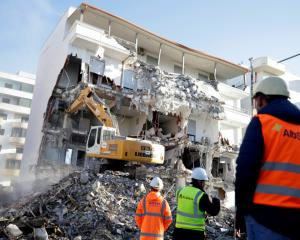 A bulldozer works at a collapsed building in Durres following the earthquake. Photo: Reuters