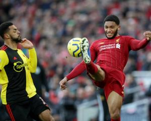 Liverpool's Joe Gomez in action with Watford's Andre Gray. Photo: Reuters