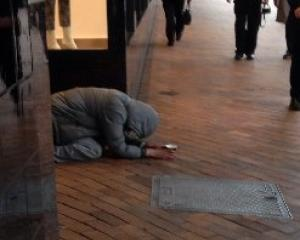 'Samuel' crouches, begging, behind an empty coffee cup in George St on Monday.  Photo by The Star.