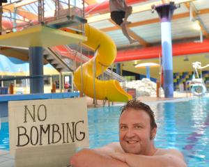 Oamaru reporter Daniel Birchfield celebrates the return of bombing at Oamaru pool.