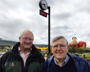 Cromwell Rotary Club members Fin White (left) and Andrew Burton unveil a new clock in Cromwell to...
