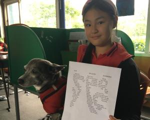 Eleven year old Isabel Wang, with rescue dog Floyd, and her shape poem for the SPCA.