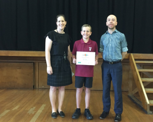 Assistant principal Amanda Chisnall, year 6 pupil Ben Dowdle and William McGrath from Specsavers....