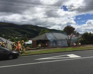 A house on Mayfield Ave has been significantly damaged by fire. Photo: Gregor Richardson