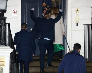 Britain's Prime Minister Boris Johnson reacts as he and his girlfriend Carrie Symonds arrive at...
