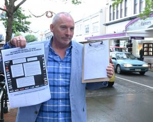 Dunedin jeweller Brent Weatherall shows off the full-page advertisement he placed in today's...