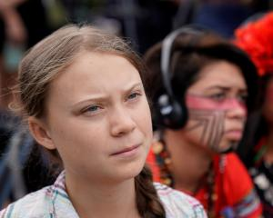 Swedish climate activist Greta Thunberg (16) listens to speakers at a climate change...