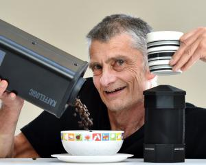 Dunedin inventor Chris Hilder shows off his Kaffelogic bean roasting device. PHOTO: PETER MCINTOSH