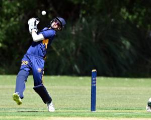 Taieri wicketkeeper Cameron Jackson bobbles a catch fromthe bat of Green Island opener Brad...
