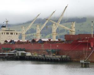 The last of the controversial phosphate is unloaded from Federal Crimson at Ravensbourne wharf...