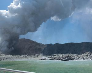 Whakaari /White Island erupted at 2.11pm yesterday sending ash 3.6km into the air. Photo: Michael...