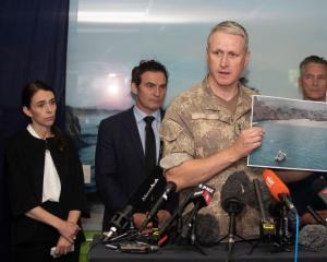 Colonel Rian McKinstry shows attendees at a press conference in Whakatane a photo taken while...